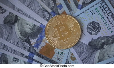 golden bitcoin coin on us dollars close up.