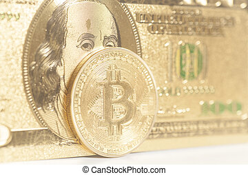 Golden bitcoin coins on us dollars
