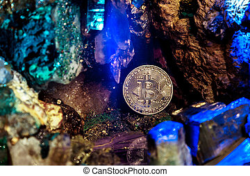 Golden bitcoin in a cave of gem stones