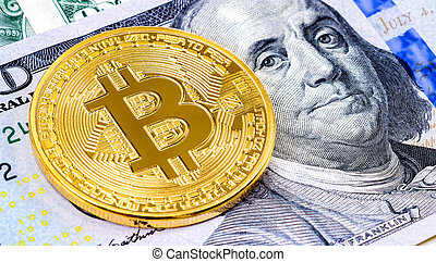 Golden bitcoin lying over one hundred american dollars bill close up