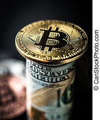 Golden bitcoin on a 100 dollar bill