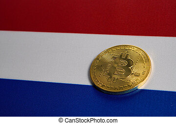 Golden Bitcoin on the flag of Netherlands. Close-up, copy space