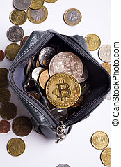 golden bitcoin over money coins in wallet around international currency coins