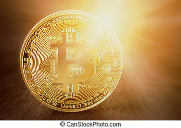 Golden bitcoin with shine. conceptual image for crypto currency.