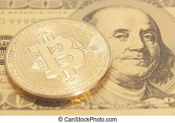 Golden bitcoin with U.S. dollar close up