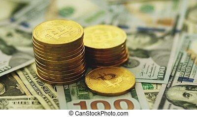 Golden bitcoins and banknotes - Close-up shot of stacked...