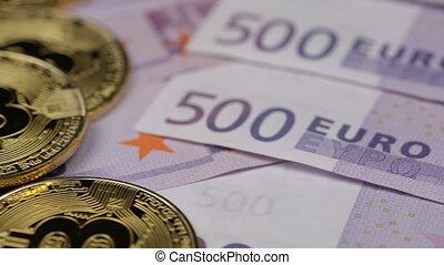 golden bitcoins and five hundred euros, close up