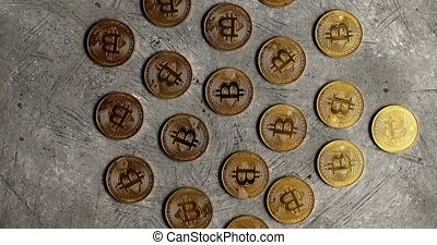 Golden bitcoins on gray surface - Top view of few golden...