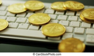 Golden bitcoins on keyboard - Close-up shot bright gold...