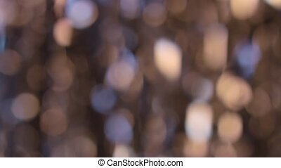 Golden blurred abstract sparkles lights. Bokeh background