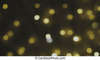Golden, blurred, bokeh lights background. Abstract sparkles. Full HD loop, 1080p