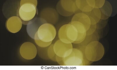 Golden, blurred, bokeh lights background. Abstract sparkles....