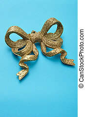 Golden bow isolated on a blue background