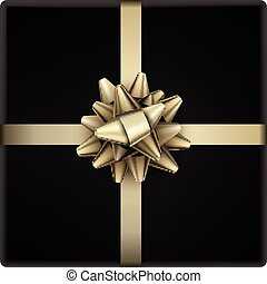 Golden bow with ribbon isolated on black.