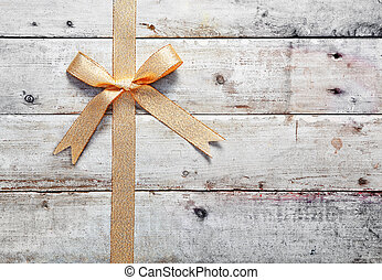 Golden bow with woodgrain copyspace