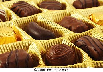 praline - golden box of praline candy showing love concept