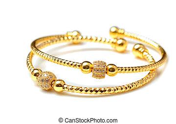 Golden bracelets , isolated on white background