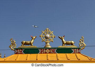 Golden brahma symbol on reef top of buddhis temple around Boudha Nath (Bodhnath) stupa in kathmandu, Nepal