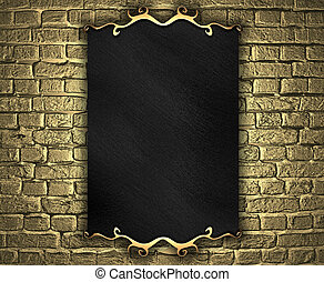 golden brick wall with black nameplate. Design template
