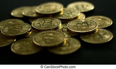 Golden bright bitcoin in pile - Close-up shot of pile of...