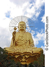 Golden Buddha sitting in the lotus position