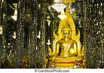 Golden Buddha statue at Cathedral glass, Temple in Uthai...