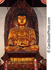 Golden buddha statue in a temple in Shanghai, China