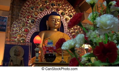 golden Buddha statue in Dharamsala temple,Himachal...