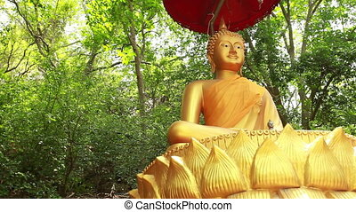 Golden Buddha statue - Golden statue of Buddha in temple in...