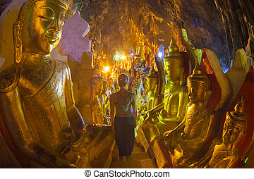 Golden Buddha statues in Pindaya Cave located next to the town of Pindaya, Shan State, Burma (Myanmar) are a Buddhist pilgrimage site and a tourist attraction.