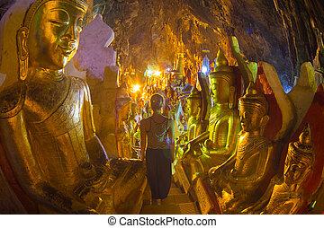 Golden Buddha statues in Pindaya Cave, Burma (Myanmar). -...