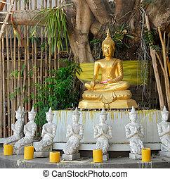 Golden Buddha under a Bodhi tree