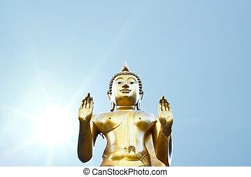 Golden Buddha under the sun.