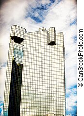 Golden building against cloudy blue sky