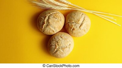 Golden buns of bread and wheat - Top view of arranged round...