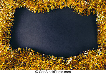 Golden carnival or new year frame over black background