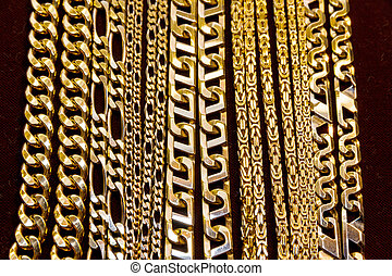 A collection of different types of heavy golden chains