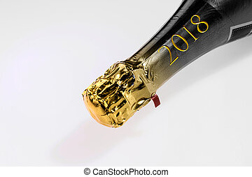 Golden champagne neck with the inscription 2018