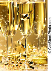 Golden champagne sparkle with fluted glasses and party...