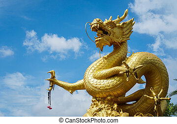 Golden Chinese dragon statue on blue sky background in ...