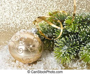golden christmas ball with christmas tree branch