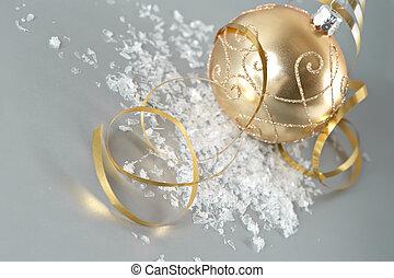 golden christmas ball with golden streamer