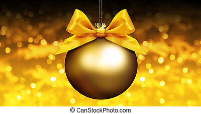 golden christmas ball with ribbon bow on golden blurred lights background