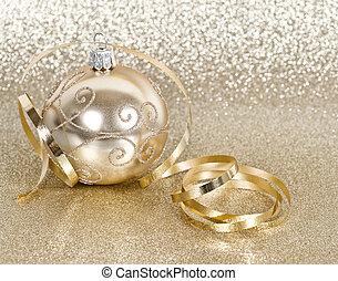 golden christmas ball with streamer