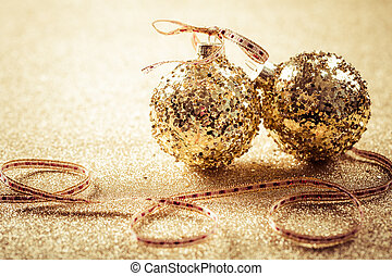Golden christmas balls on glitter background with copy space