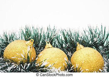 golden christmas balls on white, horizontal