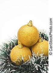 golden christmas balls on white, vertical
