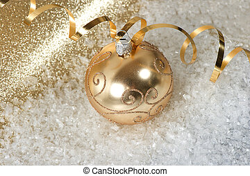 golden christmas bauble over shiny background