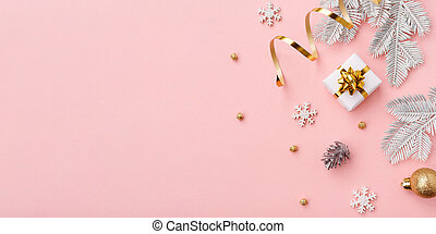 Golden christmas decoration on pink background with copy space