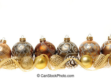 Golden Christmas decorations with gold balls and ornaments on white background